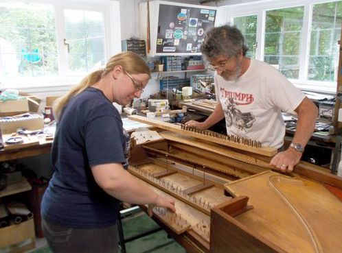 Square piano restorers at work