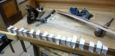 Square Piano taped for glueing woodwork